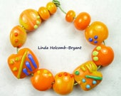 Lampwork Glass Bead Set of Mixed orange Beads- set of 12