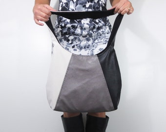 leather purse in color block hobo bag style. choose medium or large purse shoulder or cross body bag. faux leather silver, black, off white.