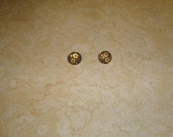 vintage clip on earrings goldtone black embossed flowers