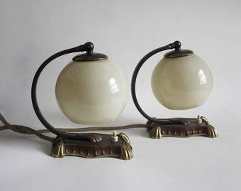 Pair of 1950s Art Deco Table Lamps. Brass ornate bases, Beige globe glass lampshades