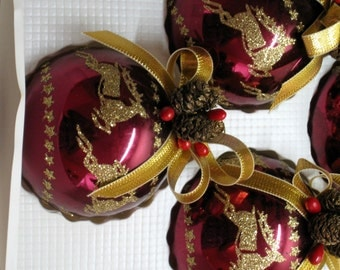 "Rauch, Victoria Collection Set of 8 Purple 2 1/2"" Glass Ornaments With Gold Glitter Reindeer, Pine Cones & Gold Ribbon"
