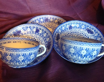 2 Antique blue and white tea cups and saucers tea cup geometric patterns and flowers 4 raised flowers At Everything Vintage Shipping's on Us