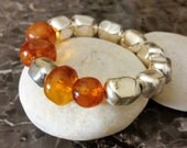 BALTIC AMBER BRACELET:  Natural, unheated Baltic Cognac Amber , silver filled beads Stretchable bracelet