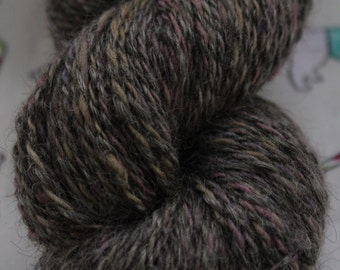 140gms 100% pure wool, natural grey with a muted lilac blend. DK weight.