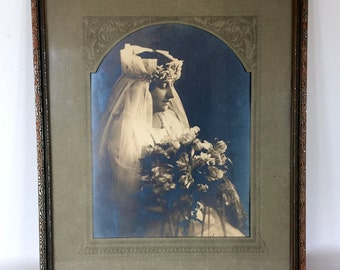 Antique frame with a Bride's picture