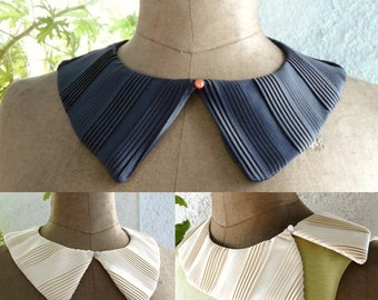 Navy blue or off-white pleated detachable collar.
