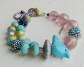 Spring Day - handmade  artisan bead bracelet with bird detail with handwoven and lampwork glass in turquoise, aqua and purple - Songbead, UK