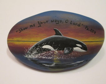 Killer Whale and Bible Verse hand painted on a rock by Ann Kelly