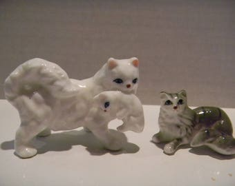 Vintage miniature cat figurines..Mama kitty carrying her kitten plus little grey cat