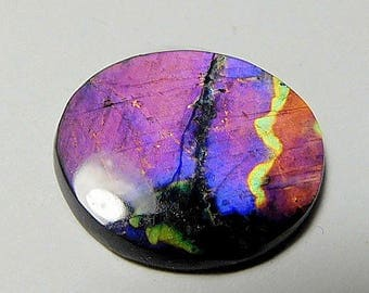 Spectrolite   designer cab AA+  super blue and purple buff top oval ,with a violet ,purple  pattern 3.33 ct.Ylamma Finland