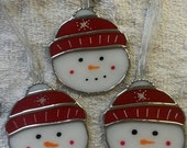 Stained glass snowman faces