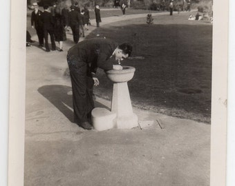 Man Drinks From Drinking Fountain Vintage Snapshot Black And White Fashion Photo Handsome Gentleman Photograph