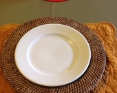 Six white Buffalo China restaurant type plates, stamped USA 77 on back with stars to right and left.
