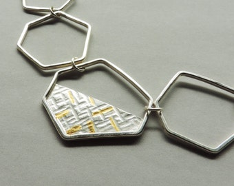 Geometry Necklace, contemporary statement necklace in silver and gold mixed metals.
