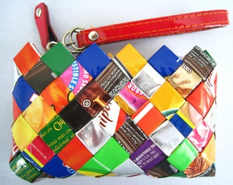 NAHUI OLLIN Wristlet in True Multicolor with Red Detachable Wrist Band and Red Zipper.  Woven with Foil Gum & Candy Wrappers.