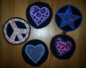 Set of 5 handmade patches. Circle badges. 3 with hearts, one orange peace sign, one star. Black Decal appliques with blue pink gey