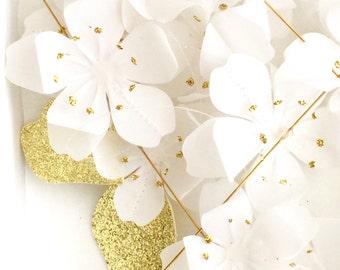 Baby mobile. Sakura. Cherry blossom. Hanami. White and gold glitter. Kids room decoration. Baby, infant, children.