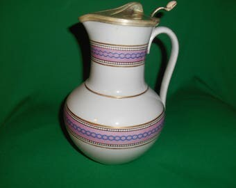 One (1), Antique, Semi-Porcelain Pitcher, with Silver Plated Cover.