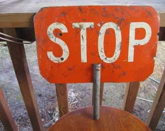 Stop sign backed with slow sign, hand held rectangular flagger or  school crossing, 50's