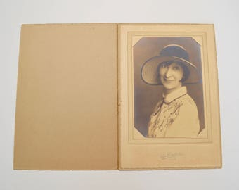 antique sepia photograph: portrait of woman in hat in folder embossed framing folder