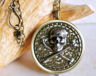 Skull and Crossbones music box locket, round locket with music box inside, and skull and crossbones on front cover