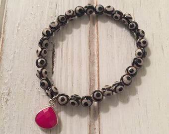 Black and white evil eye bracelet with hot pink chalcedony gemstone charm; hot pink; evil eye; stack bracelet; womans bracelet