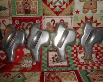 Four Vintage Santa Claus Cookie Cutters/Ornaments
