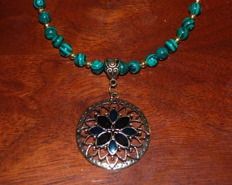 Malachite Necklace with Gold Spacers, Toggle Clasp and Gold Metallic/Green and Red Pendant   20 in.