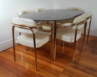 Hollywood Regency brass and leather dining set