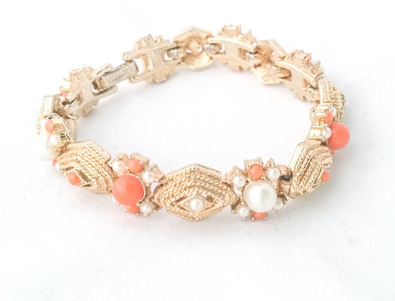 Vintage gold tone faux white pearl orange lucite etched bracelet by Celebrity