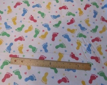White with Red/Green/Blue/Yellow Footprints Flannel Fabric by the Yard