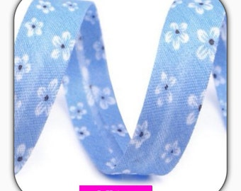 Bias tape, polyester, light blue with flower 14 mm, 1 meter, folded,