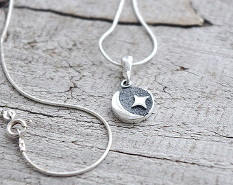 Sterling silver pendant with star and moon motive.