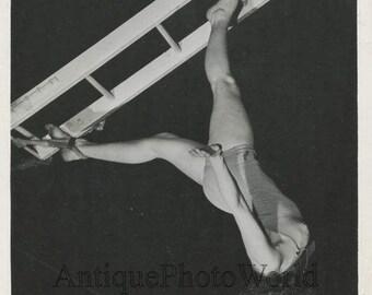 Beautiful woman circus acrobat aerialist vintage photo
