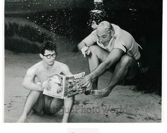 Two men under water reading art photo by B. Mozert