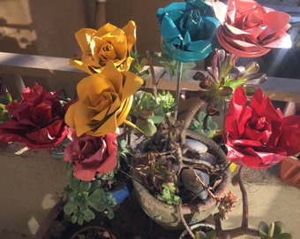Upcycled spray paint cans turned roses