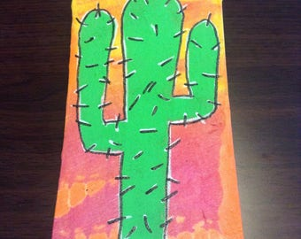 Cactus on tie-dyed background