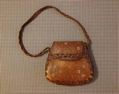 1960's/70's, stitched, leather, saddle purse, with colorful branded and painted flowers