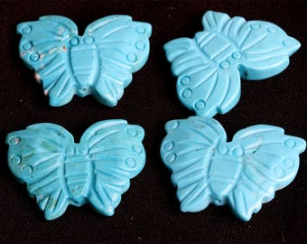 Four 30 mm Turquoise Carved Butterfly Stone Beads