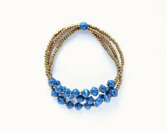 Dark blue and gold beaded bracelet