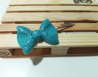 1 hair clip with blue bow