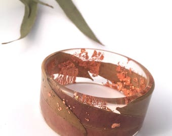 Australian gum leaf eco-resin bangle with embedded highlights of copper leaf flakes.