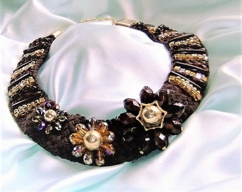Statement necklace in Brown and gold colors, braided, embroidered