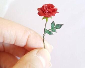 Alice in wonderland painted red rose