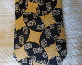 "100% silk, Italian made men's necktie, Claiborne, gold, black, silver, 55"" long, 4"" at widest point, accessories, prof. cleaned"