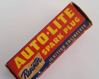 Vintage 1948 Auto-Lite Resistor Spark Plug in original box with coupon wrapping the plug. Automobilia, car collectible.