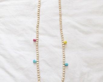 Pink blue yellow pom pom necklace