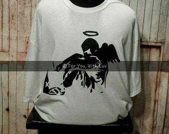 Banksy Fallen Angel T shirt. Banksy Art Shirt