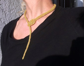 Golden snake necklace. An ancient jewel of contemporary design.