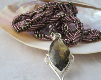 Smoky brown pendant with silver plated bezel